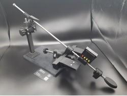 Точилка для ножей с поворотным и реечным механизмами